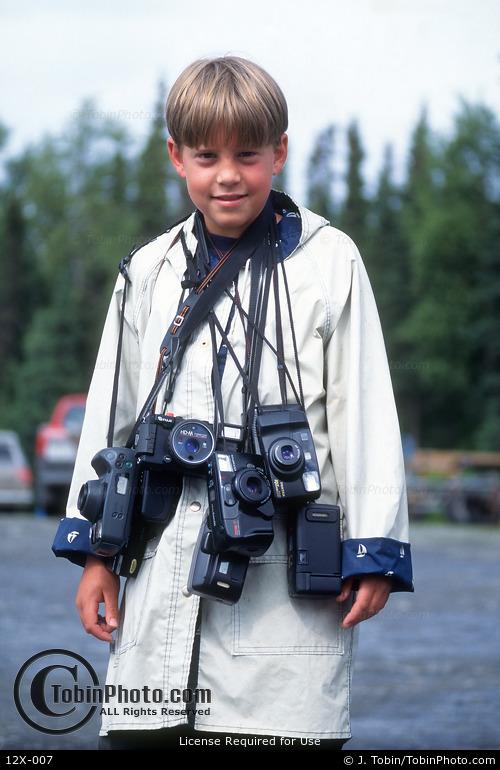 Boy with Cameras