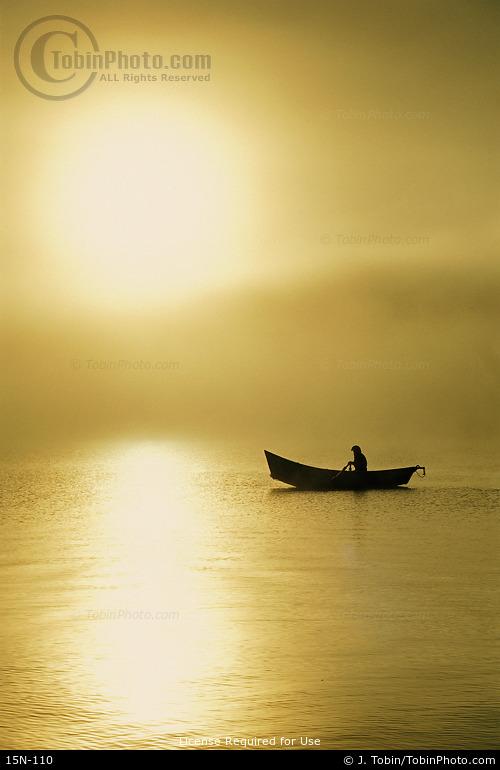 Boat in Fog at Sunrise